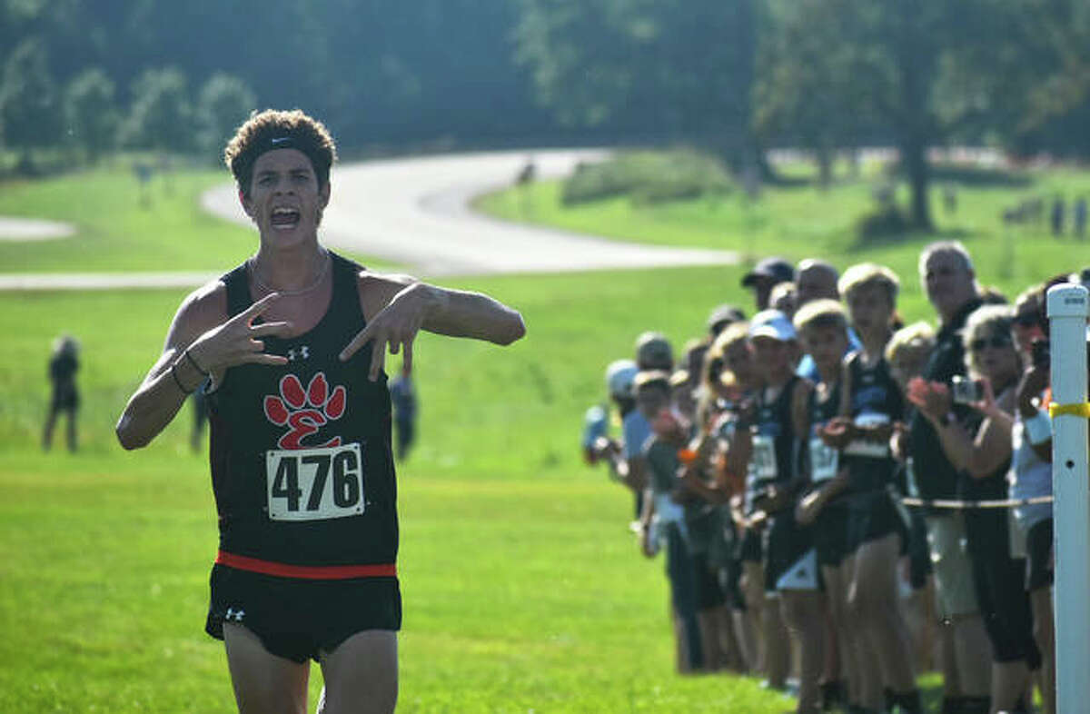 Edwardsville's Geordan Patrylak celebrates as he crosses the finish line to win the Edwardsville Invitational on Saturday at SIUE. Runners get off to a fast start at the Edwardsville Invitational on Saturday. EHS senior Ryan Luitjohan is pictured second from the left.