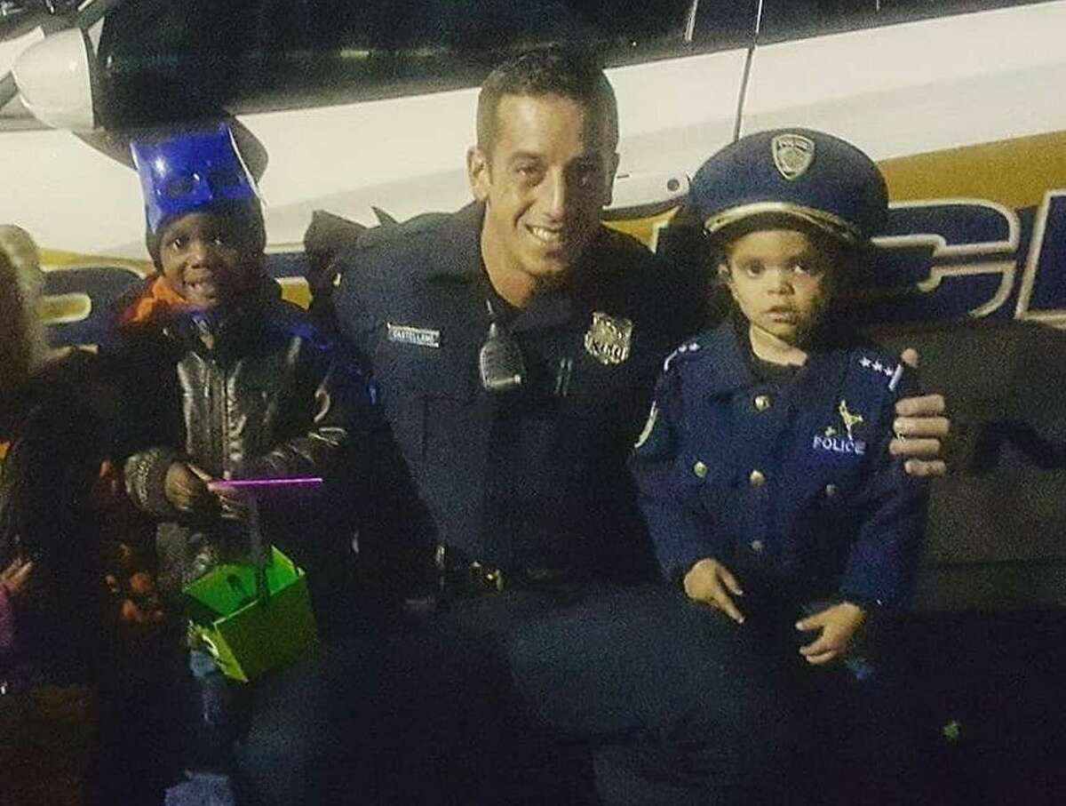 In this undated photo, New Haven Police Officer Joshua Castellano is seen working with children while in uniform.