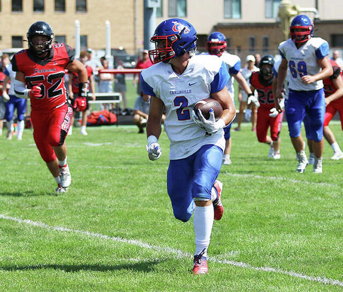 Carlinville's Carson Wiser runs from defenders in a Week 1 win at Gibson City. On Friday in Gillespie, Wiser had nine receptions for 126 yards in the Cavaliers' SCC win over the Miners.