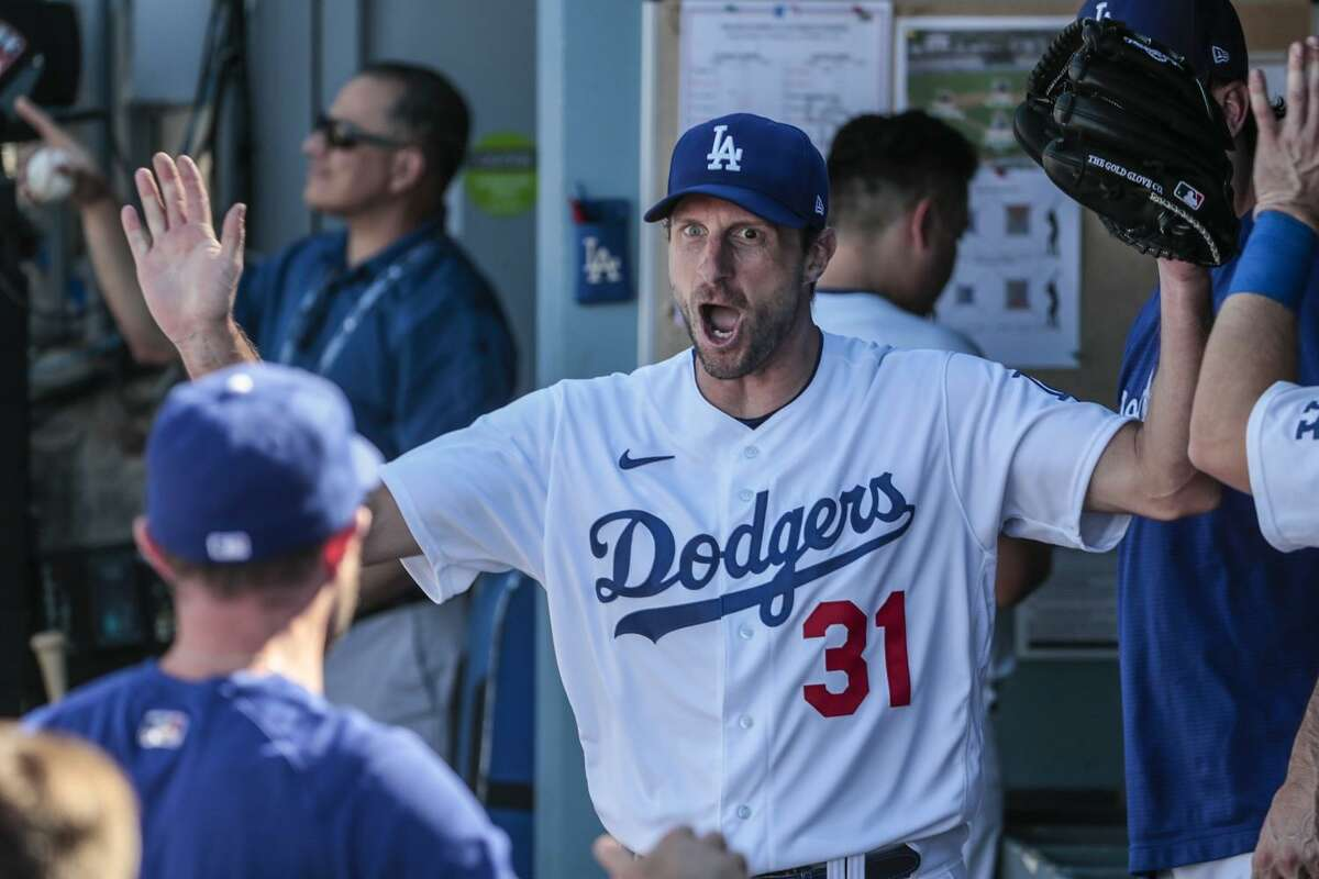 Los Angeles, CA, Sunday, September 12 2021 - Los Angeles Dodgers starting pitcher Max Scherzer (31) exults in the dugout after completing seven shutout innings on one hit against the San Diego Padres at Dodger Stadium. (Robert Gauthier/Los Angeles Times)