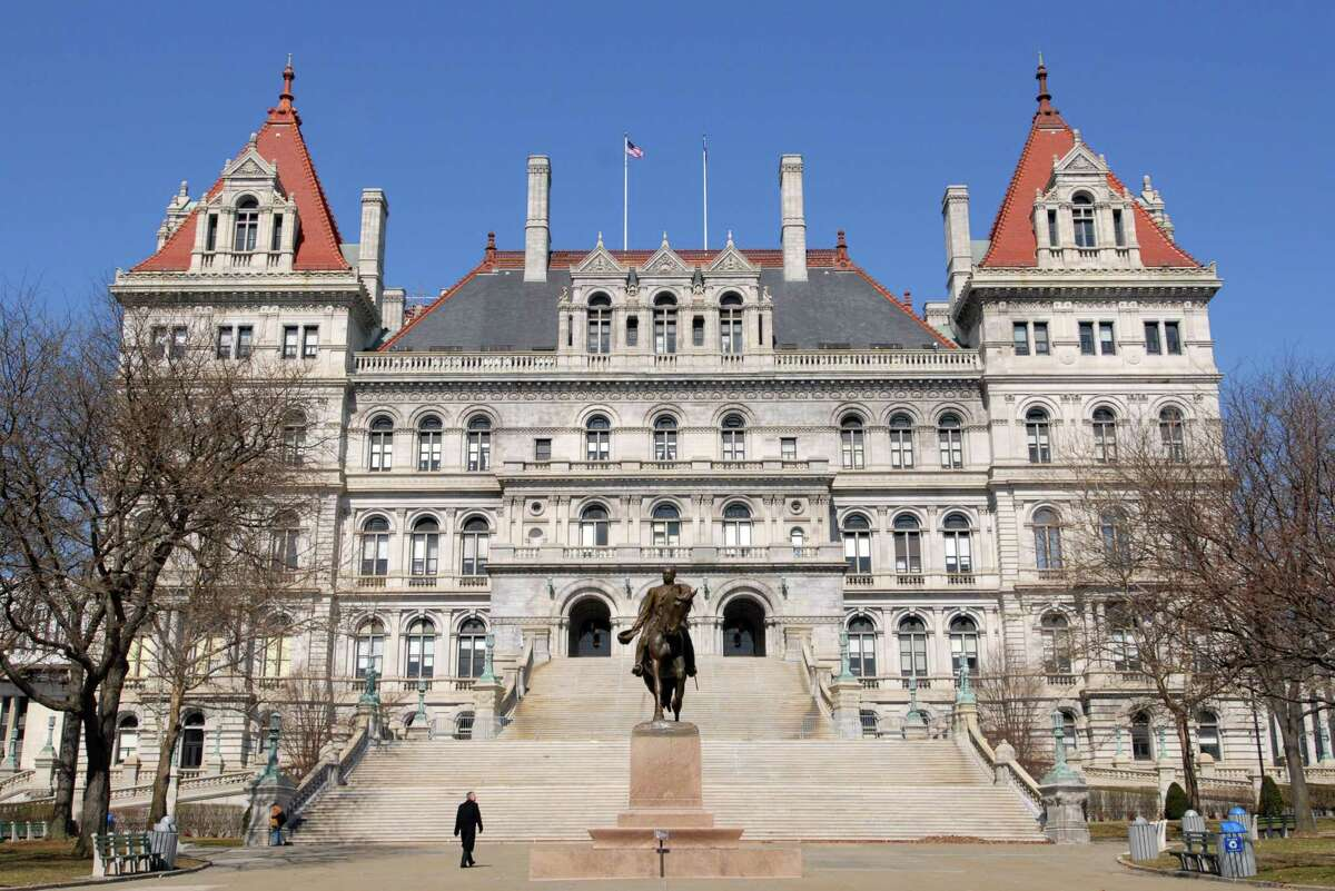 Just under 400 state employees are benefiting from a system that caps their annual pensions based on the governor's salary. Photo: Will Waldron/Times Union