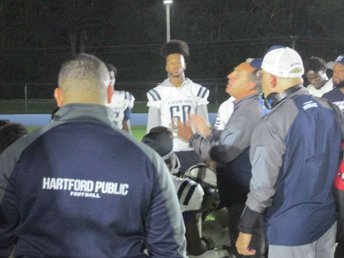 Hartford Public coach Harry Bellucci's instructions to stick together evoked a come-from-behind win for the Owls at Lewis Mills High School Friday night.