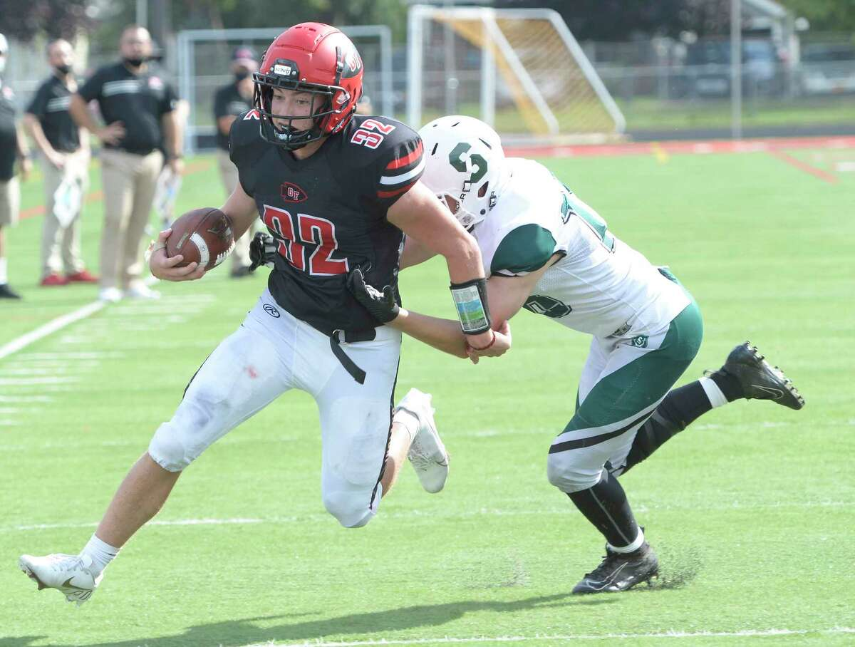 Glens Falls running back Griffin Woodell gains yardage against Schalmont earlier this season. He had 326 yards in the game.