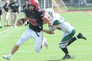 Schalmont's 18 attempts to tackle Glens Falls running back Griffin Woodell during a game Saturday, Sept. 18, 2021, in Glens Falls, N.Y. (Jenn March, Special to the Times Union)