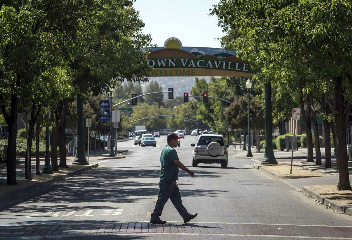 A man walks along Main Street in Vacaville. Solano County, has had the Bay Area's poorest record on coronavirus cases and vaccinations