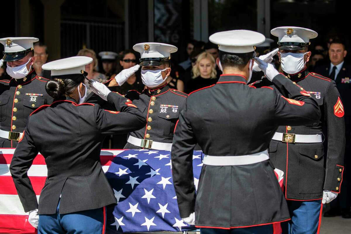 U.S. Marines pallbearers salute Gee's casket during the memorial service. Gee was one of dozens killed in a bombing attack at the Kabul airport on Aug. 26.