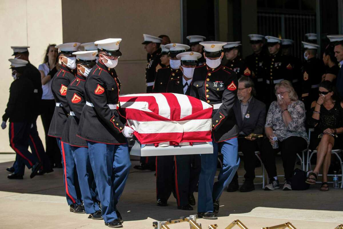 Marines carry the casket of Sgt. Nicole Gee during a public memorial service at Roseville's Bayside Church.