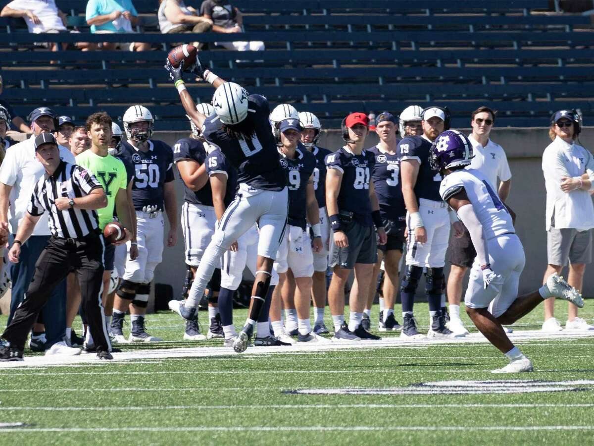 Yale wide receiver Darrion Harrington goes high for a reception in Yale's 20-14 loss to Holy Cross on Saturday.