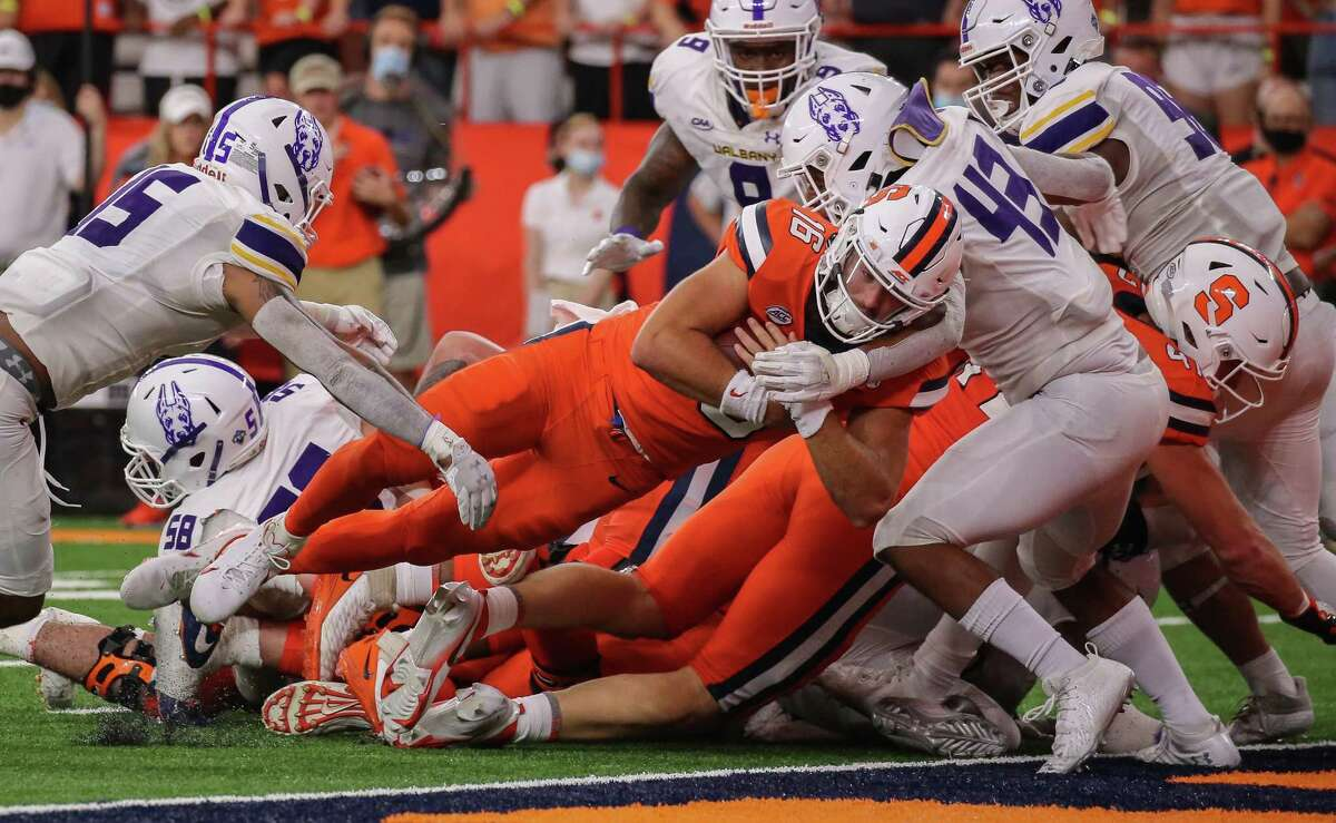 Syracuse quarterback Garrett Shrader dives into the end zone to score in the last 32 seconds of the first half. He later scored another rushing TD in the second half against UAlbany on Saturday, Sept. 18, 2021, at the Carrier Dome.