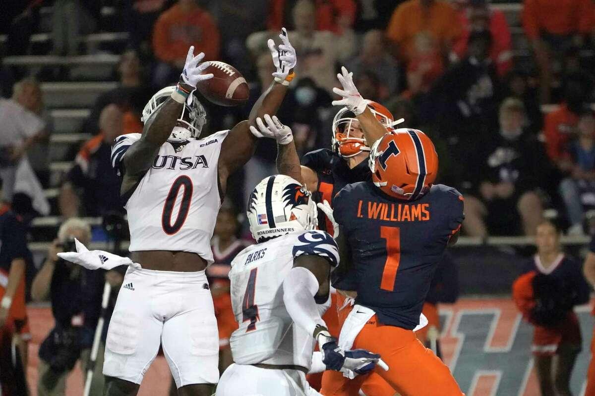 UTSA's Rashad Wisdom (0) breaks up a pass intended for Illinois' Isaiah Williams during the second half of an NCAA college football game Saturday, Sept. 4, 2021, in Champaign, Ill. (AP Photo/Charles Rex Arbogast)