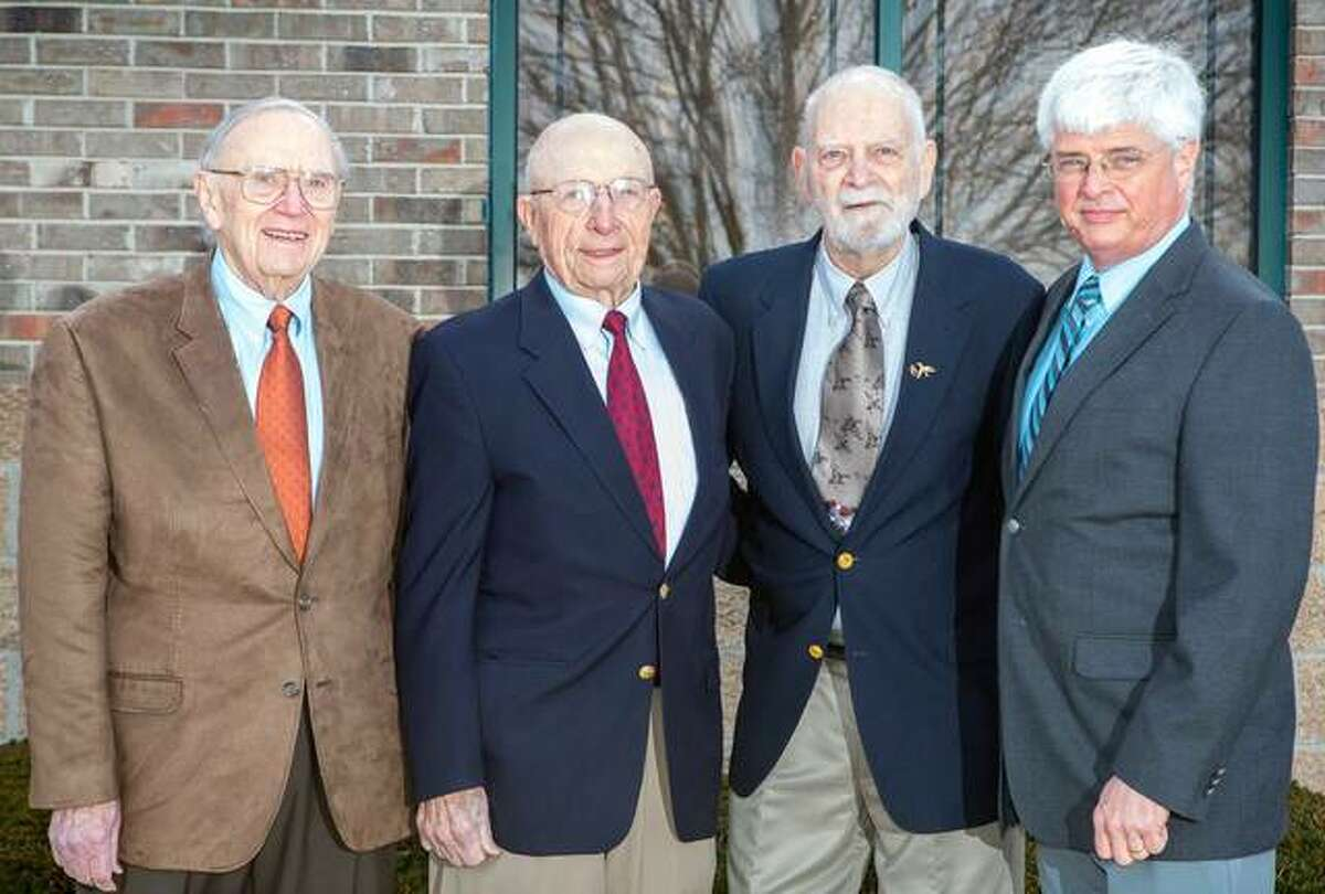 Hawthorne Animal Hospital in Glen Carbon will celebrate its 65th year on Sunday, Sept. 26. Pictured are Dr. Merrill Ottwein, Dr. Joe Helms, Dr. Art Lippoldt and current owner Dr. Paul Myer.