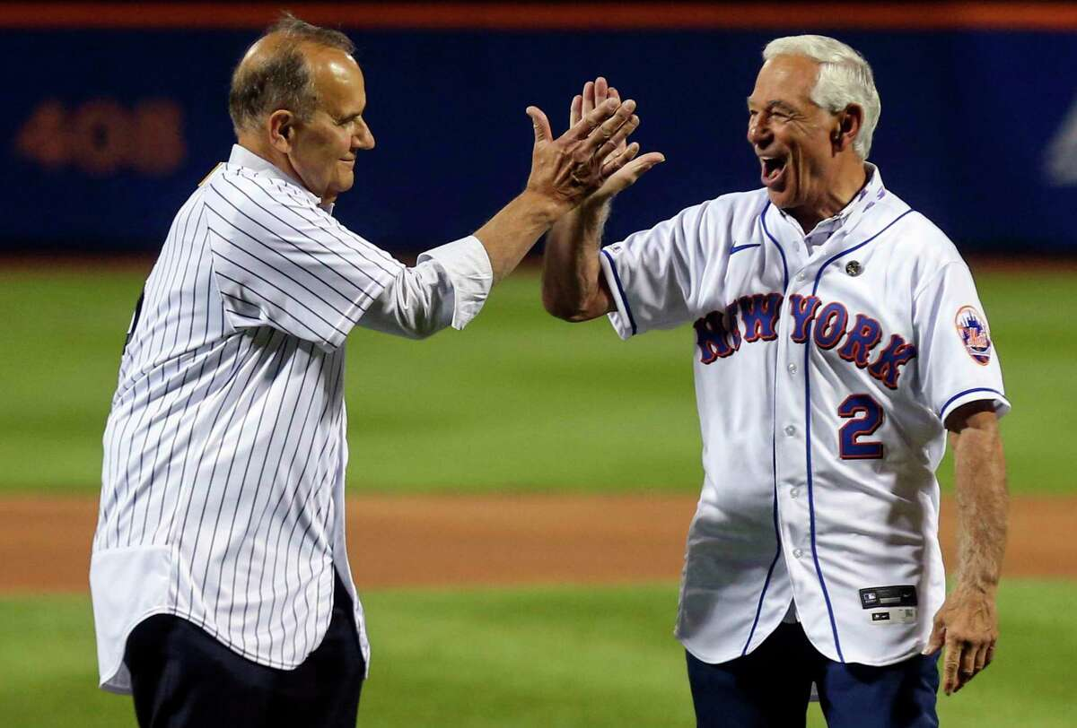 Former New York Yankees manager Joe Torre, left, and former New York Mets manager Bobby Valentine react after they threw out ceremonial first pitches before a baseball game Saturday, Sept. 11, 2021, in New York.