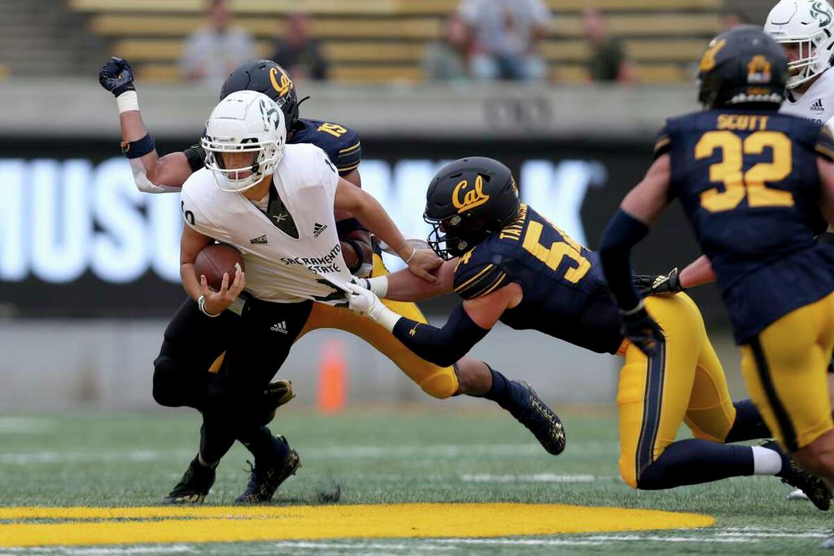 Sacramento State quarterback Asher O'Hara (10) is tackled by California linebacker Evan Tattersall (54) during the first half of an NCAA college football game on Saturday, Sept. 18, 2021, in Berkeley, Calif. (AP Photo/Jed Jacobsohn)