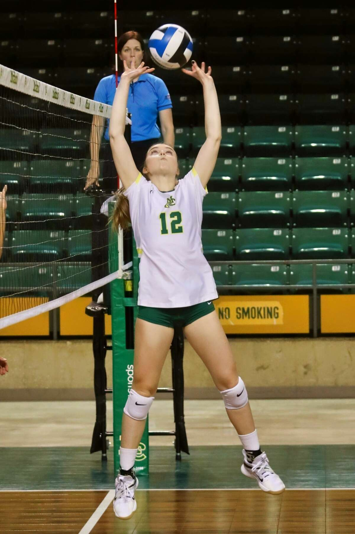 Midland College freshman Julia Kabala sets the ball during Saturday's volleyball match against New Mexico Junior College at Chaparral Center.