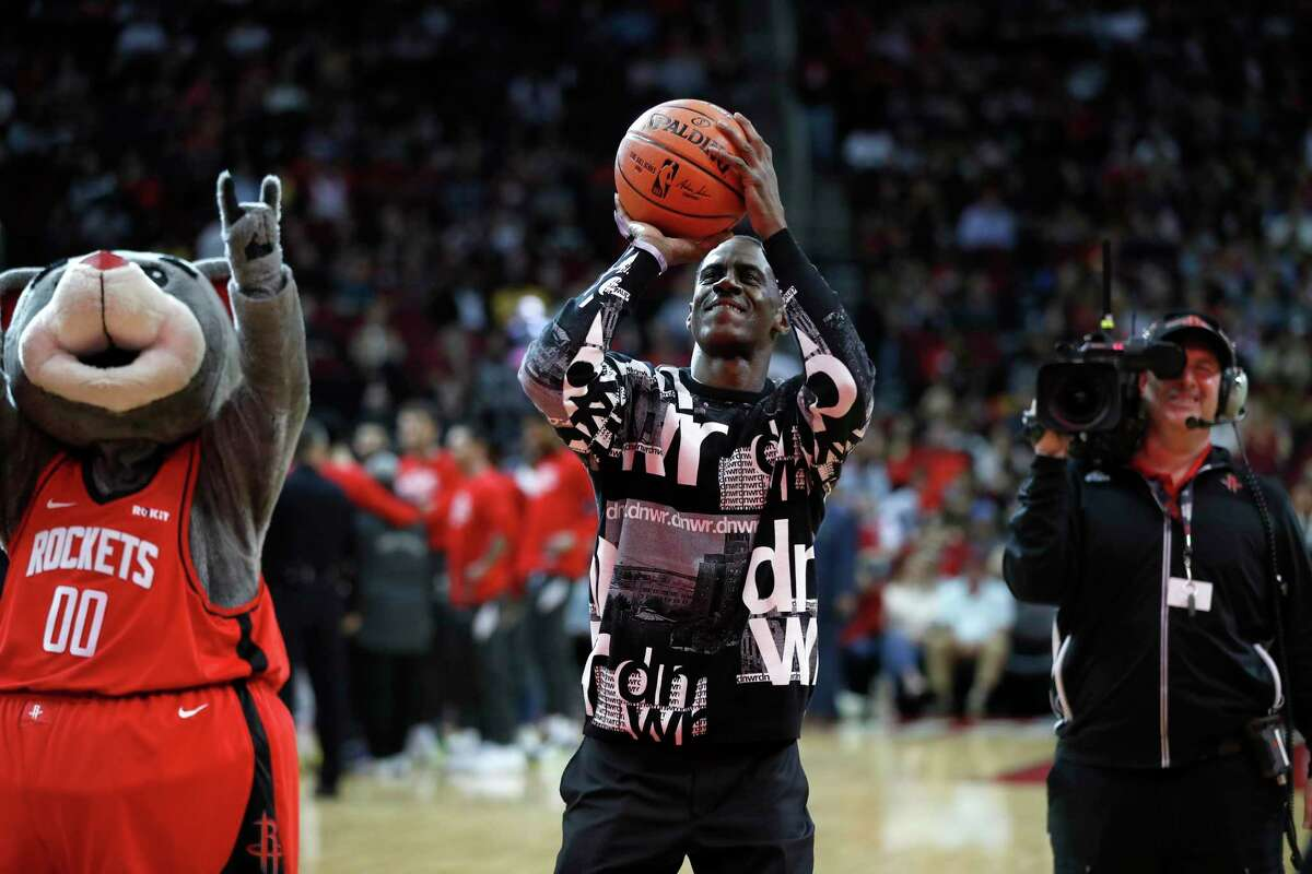 Former Houston Rockets Vernon Maxwell tries to shoot a basket before the start of the first half of an NBA basketball game at Toyota Center in Houston, Sunday, Feb. 2, 2020.