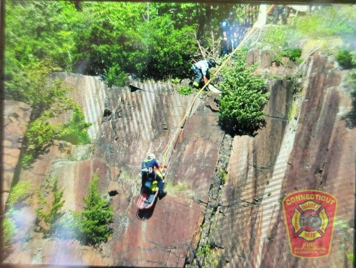 At least one person had to be rescued from the side of a cliff in New Haven's East Rock Park on Saturday.