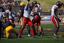 Chaz Ward celebrates after a run during the Cardinals' overtime win at Northern Colorado on Saturday.