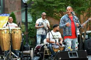 Joe Velez, right, and members of his Latin band, perform on the McLevy Green for Spanish Heritage Month Bridgeport, Saturday, Sept. 18, 2021.