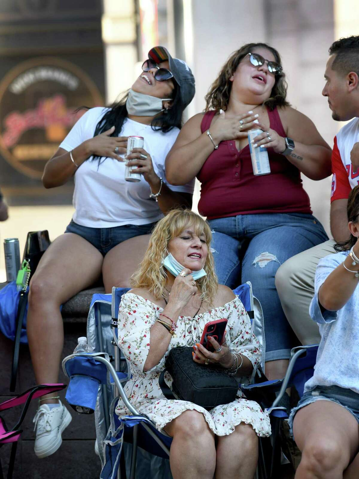 Janillex Colon, left, Erica Collazo, right and Maria Collazo, bottom, swoon to the music of Joe Velez's Latin Band Saturday, Sept. 18, 2021 on the McLevy Green in celebration of Spanish Heritage Month.