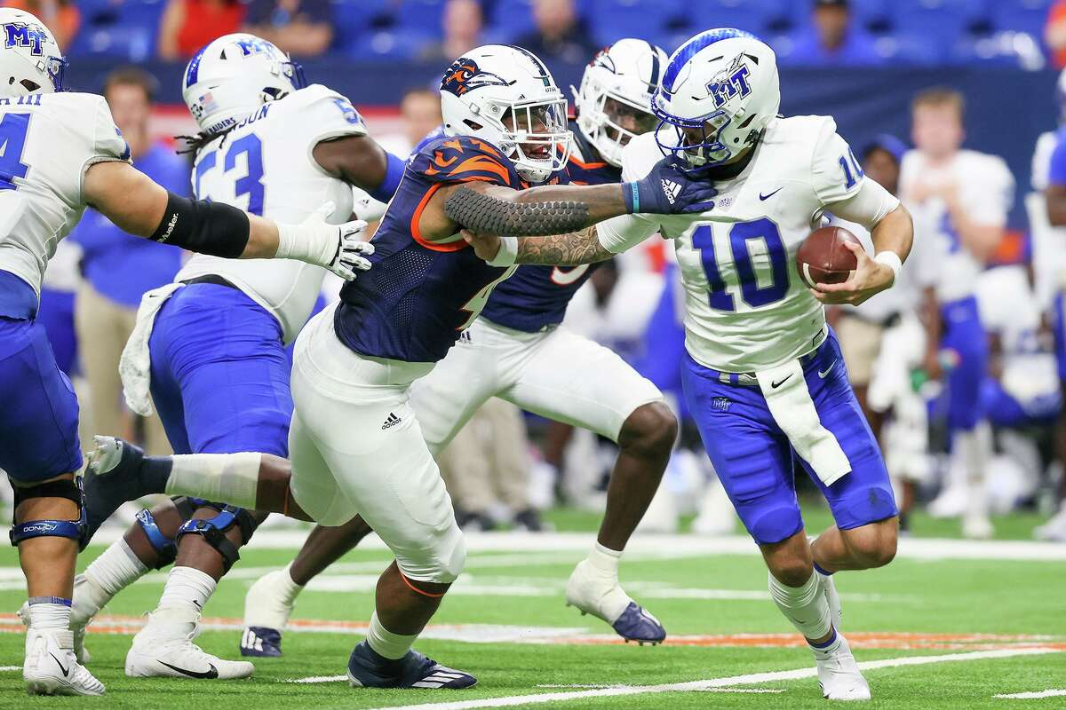 UTSA's Trumane Bell II sacks Middle Tennessee quarterback Bailey Hockman during the first half of their opening Conference USA football game at the Alamodome on Saturday, Sept. 18, 2021.