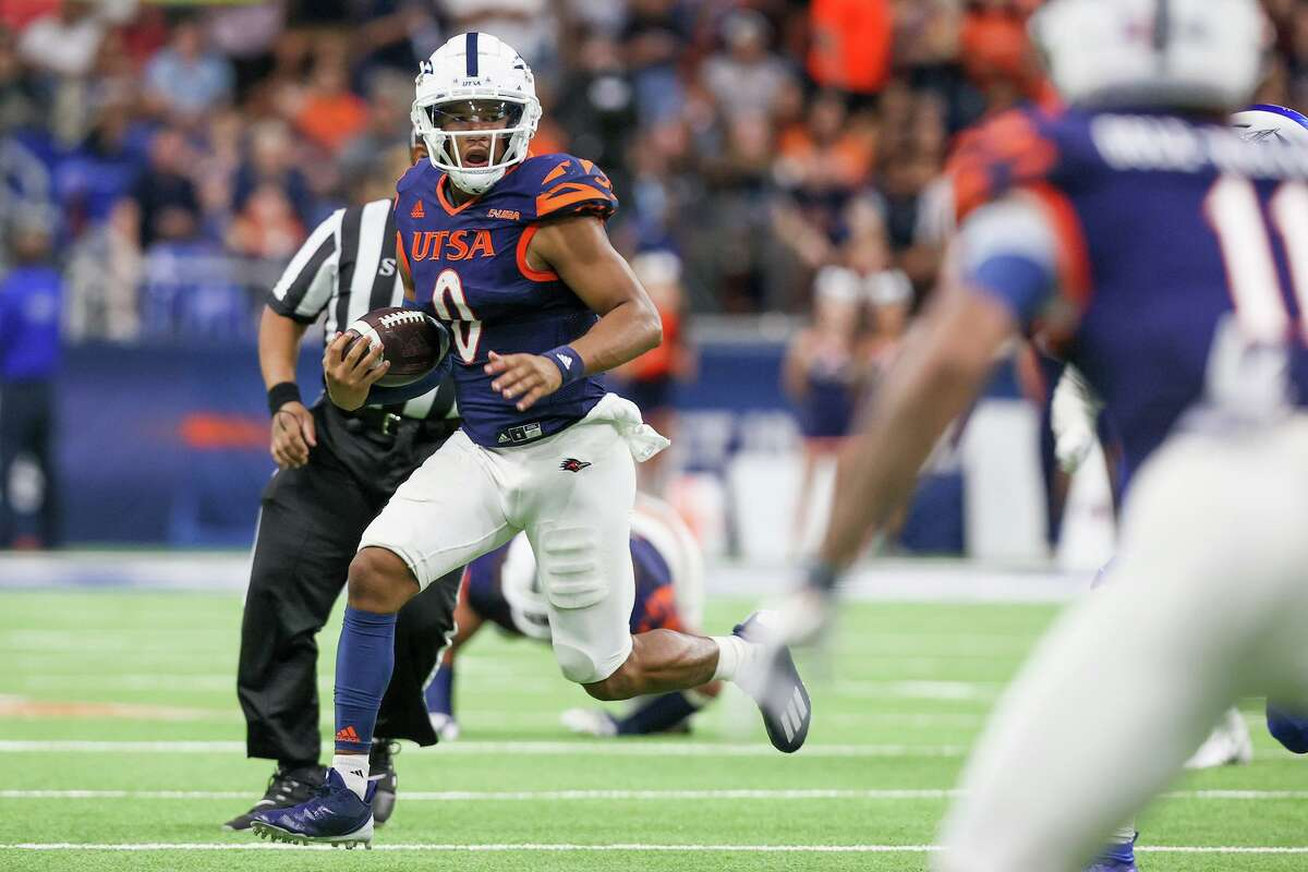 UTSA quarterback Frank Harris rolls out of the pocket during the second half of their opening Conference USA football game with Middle Tennessee at the Alamodome on Saturday, Sept. 18, 2021. UTSA beat Middle Tennessee 27-13.