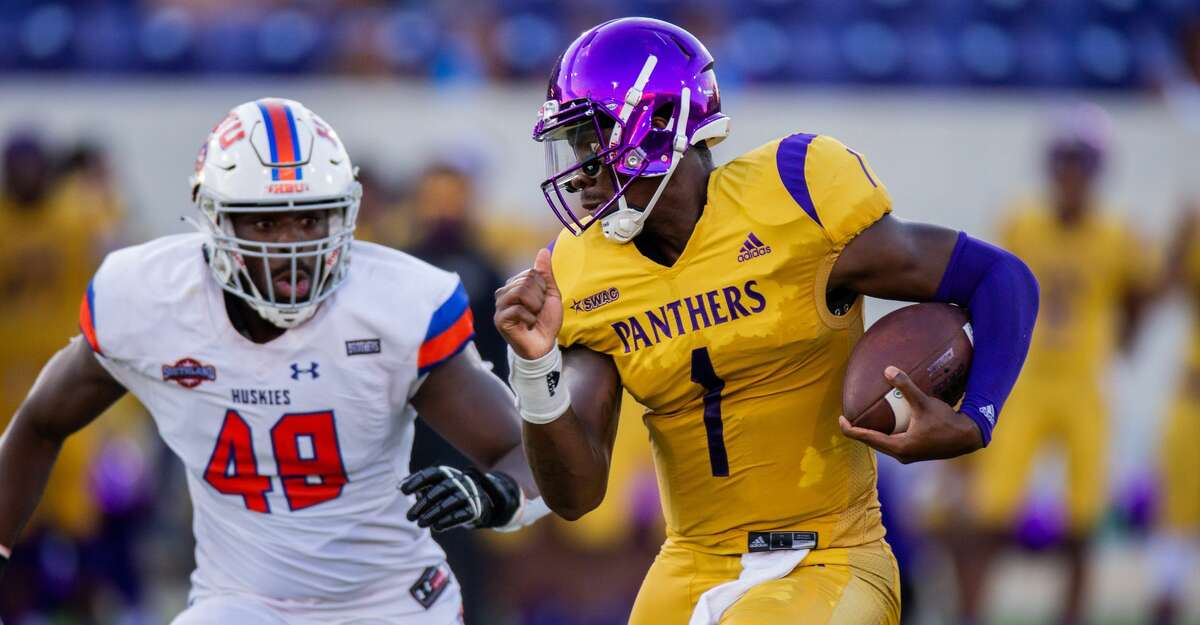 Prairie View A&M QB Jawon Pass (1) is chased by Houston Baptist University DL Philip Ossai (48) during the first half of action between Houston Baptist University vs. Prairie View A&M during a College football game at the Panther Stadiium/Blackshear Field, Saturday, September 18, 2021, in Prairie View A&M. (Juan DeLeon/Contributor)