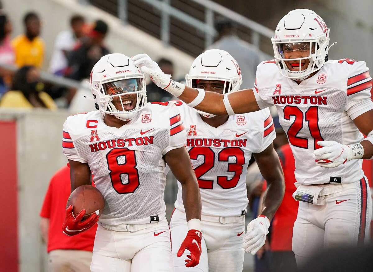 Houston Cougars cornerback Marcus Jones (8) celebrates with teammates after returning a punt for a 48-yard touchdown against the Grambling State Tigers during the second quarter of an NCAA game at TDECU Stadium on Saturday, Sept. 18, 2021, in Houston.