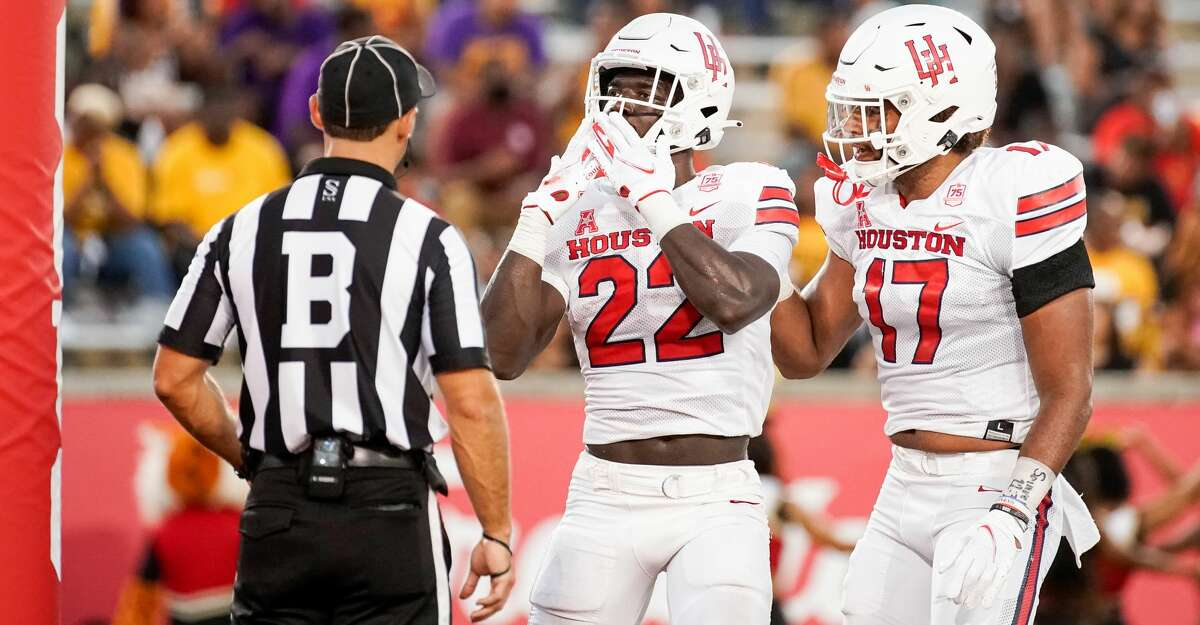 Houston Cougars running back Alton McCaskill (22) celebrates after scoring a 17-yard rushing touchdown against the Grambling State Tigers during the second quarter of an NCAA game at TDECU Stadium on Saturday, Sept. 18, 2021, in Houston.