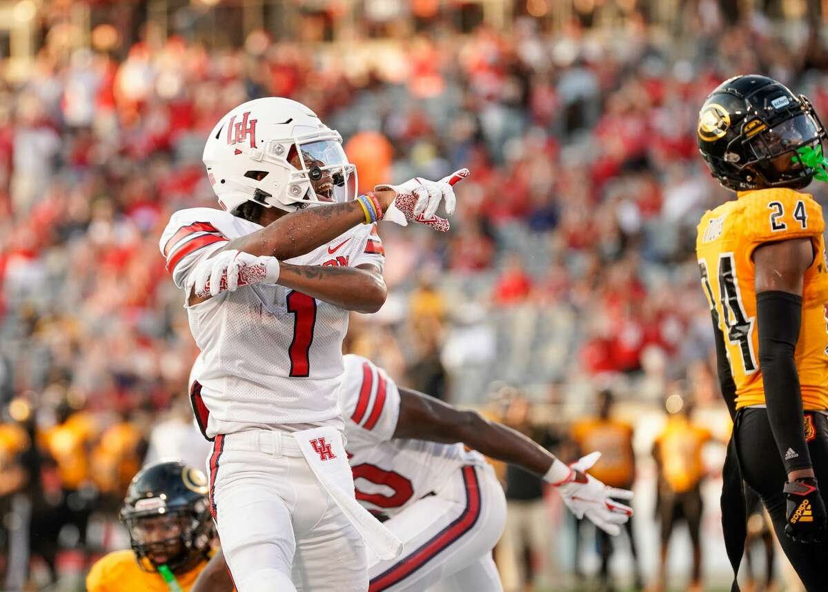 Houston Cougars wide receiver Nathaniel Dell (1) celebrates after scoring a 16-yard receiving touchdown against the Grambling State Tigers during the first quarter of an NCAA game at TDECU Stadium on Saturday, Sept. 18, 2021, in Houston.