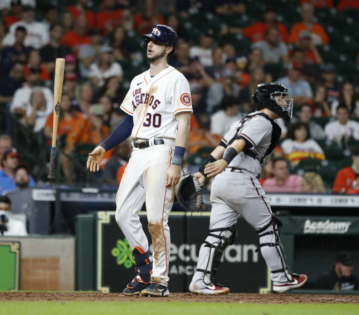 Houston Astros Kyle Tucker (30) flips his bat after striking out against Arizona Diamondbacks relief pitcher Joe Mantiply during the eighth inning of an MLB baseball game at Minute Maid Park, Saturday, September 18, 2021, in Houston.