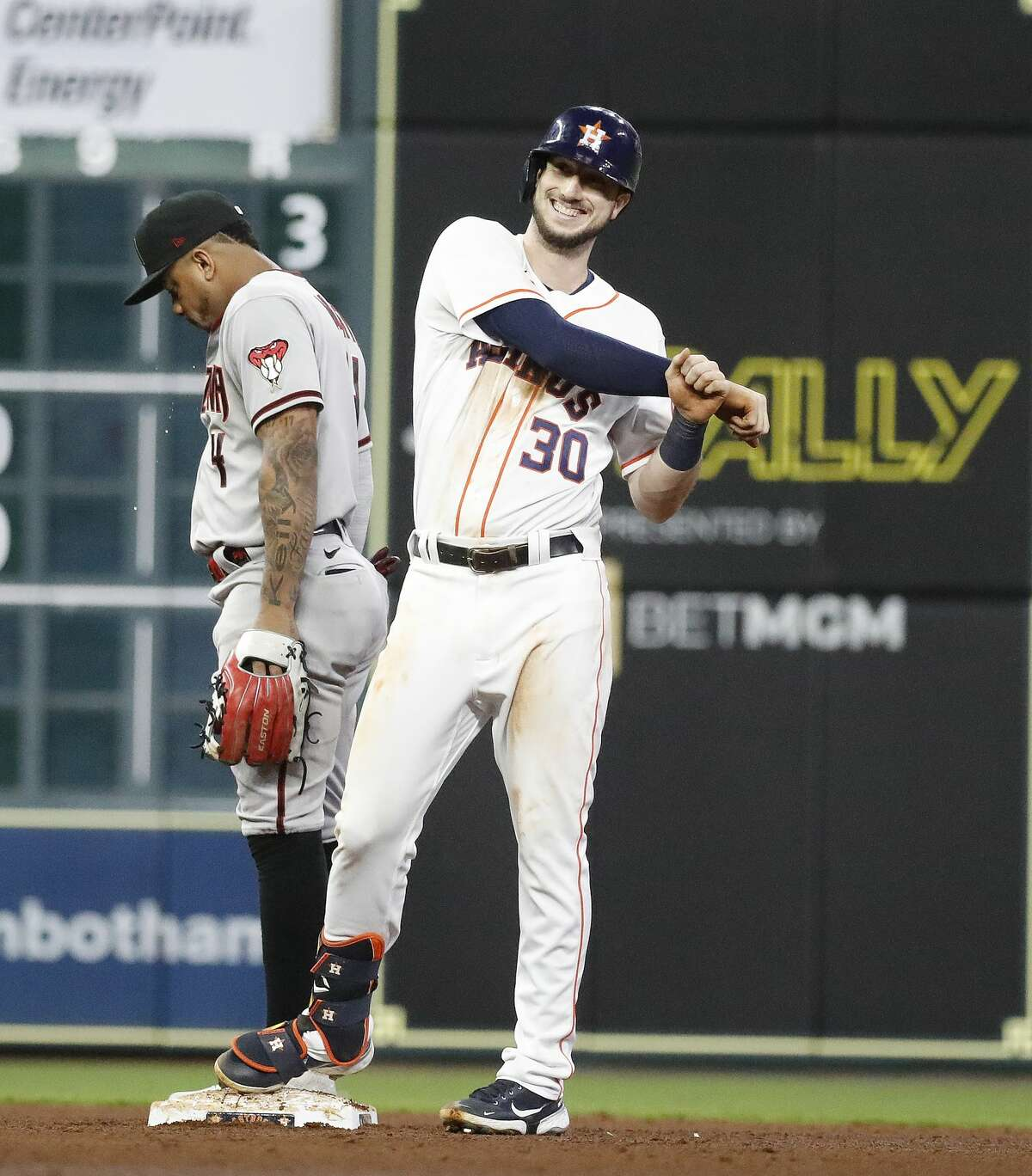 Houston Astros Kyle Tucker (30) smiles on second base after his double off of Arizona Diamondbacks starting pitcher Humberto Castellanos during the sixth inning of an MLB baseball game at Minute Maid Park, Saturday, September 18, 2021, in Houston.