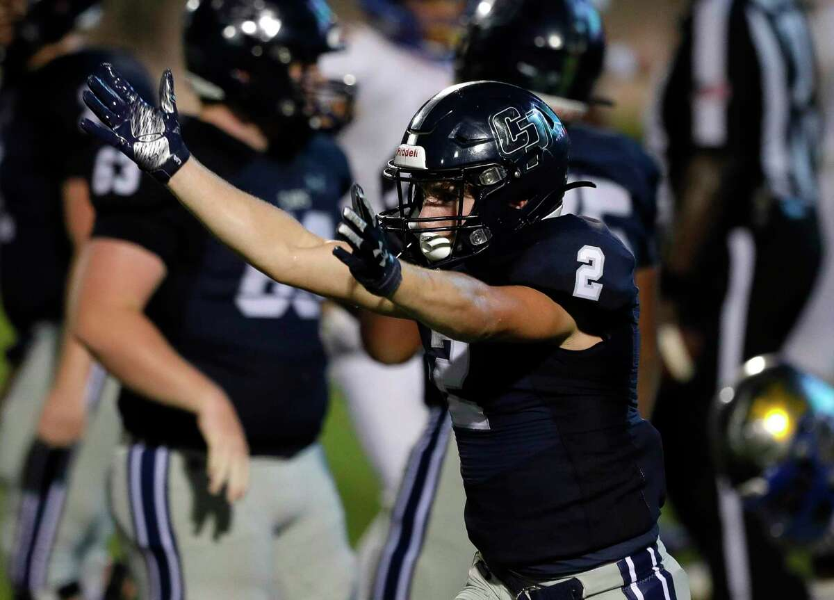 College Park wide receiver Conner Dunphy (2) blows kisses toward the stands after running for a 2-yard touchdown to take a 31-24 lead against Klein during the fourth quarter of a high school football game at Woodforest Bank Stadium, Saturday, Sept. 18, 2021, in Shenandoah.