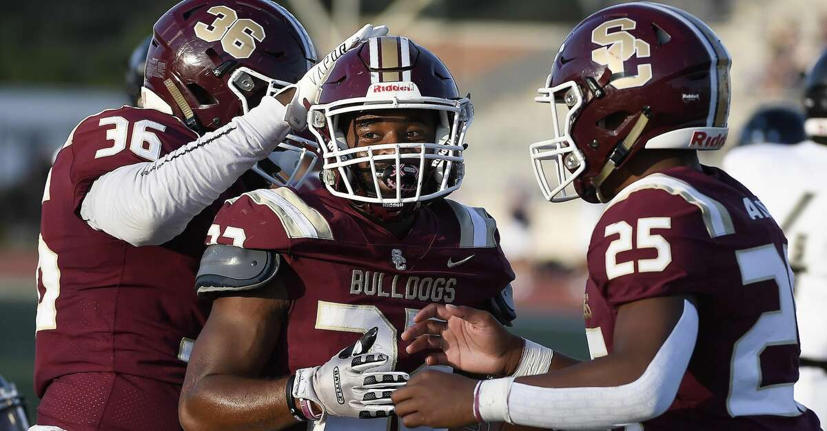 Summer Creek running back Torrie Curry, center, celebrates his touchdown with Evan Roy (36) and Llyod Avant (25) during the first half of a high school football game against Westside, Saturday, Sept. 18, 2021, in Humble.