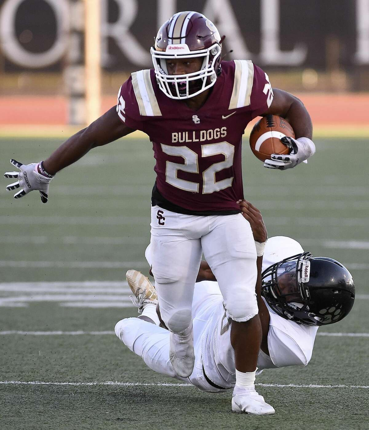 Summer Creek running back Torrie Curry (22) breaks the tackle of Westside defensive back Noah Roberts during the first half of a high school football game, Saturday, Sept. 18, 2021, in Humble.