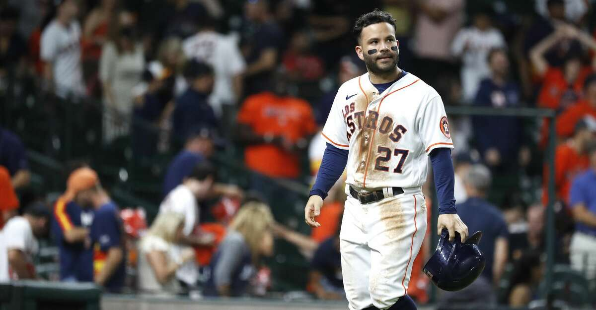 Houston Astros Jose Altuve (27) reacts as he walks back to the dugout after Yuli Gurriel flied out to Arizona Diamondbacks center fielder Jake McCarthy to end the game during the tenth inning of an MLB baseball game at Minute Maid Park, Saturday, September 18, 2021, in Houston. Diamondbacks won 6-4.