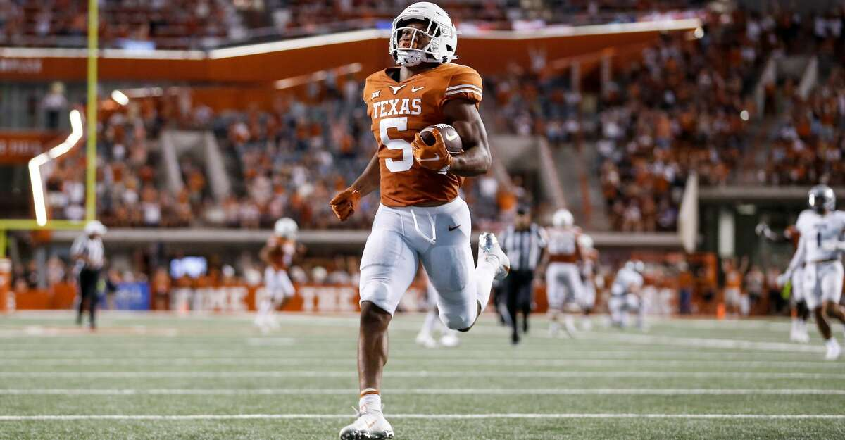 Bijan Robinson #5 of the Texas Longhorns rushes for a touchdown in the second quarter against the Rice Owls at Darrell K Royal-Texas Memorial Stadium on September 18, 2021 in Austin, Texas. (Photo by Tim Warner/Getty Images)
