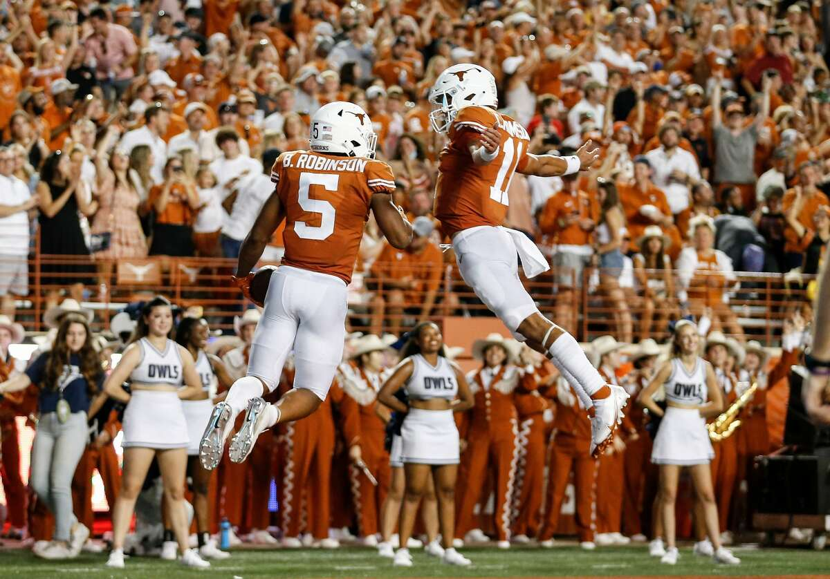 AUSTIN, TEXAS - SEPTEMBER 18: Casey Thompson #11 of the Texas Longhorns congratulates Bijan Robinson #5 after a rushing touchdown in the second quarter against the Rice Owls at Darrell K Royal-Texas Memorial Stadium on September 18, 2021 in Austin, Texas. (Photo by Tim Warner/Getty Images)