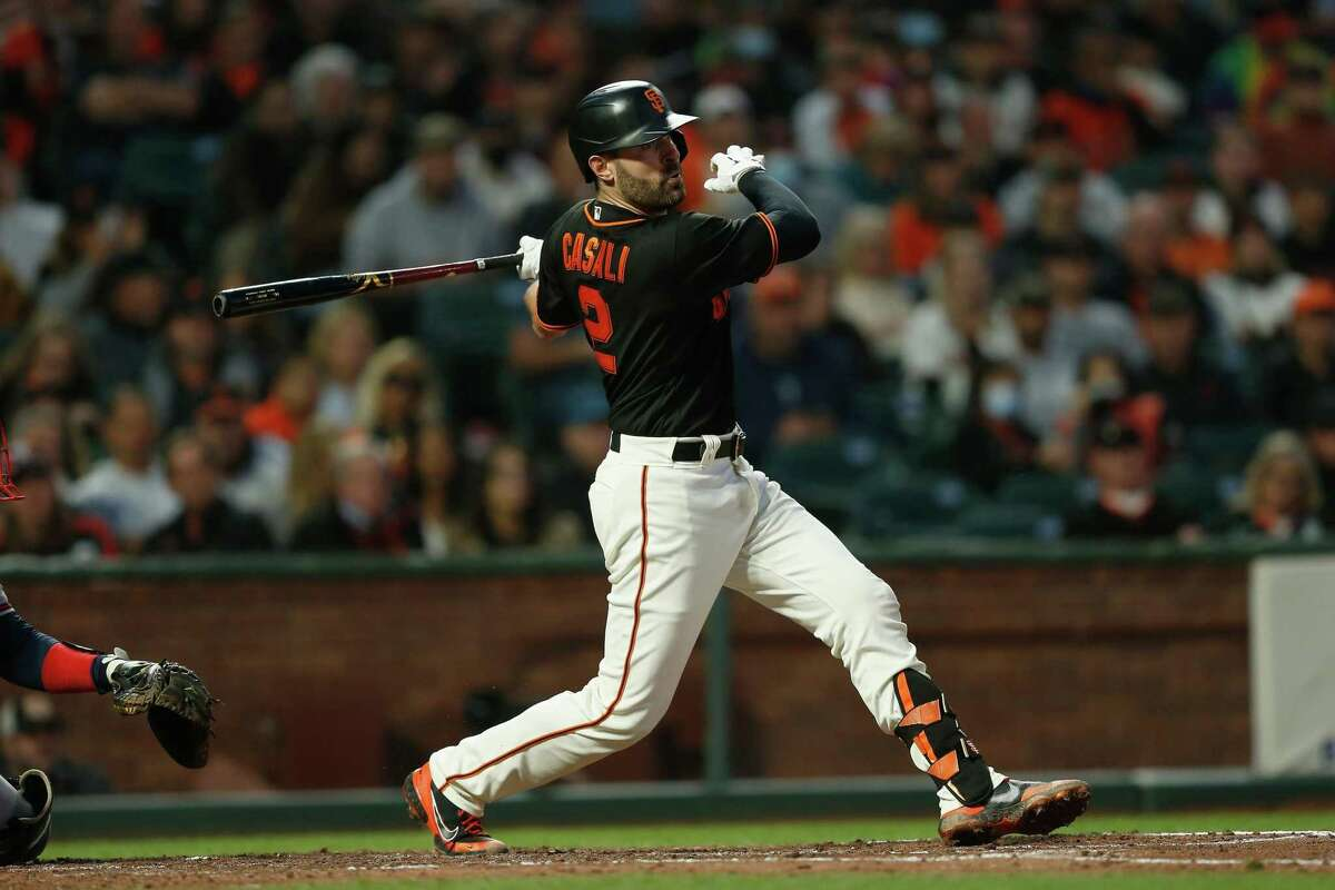 SAN FRANCISCO, CALIFORNIA - SEPTEMBER 18: Curt Casali #2 of the San Francisco Giants hits a two-run single in the bottom of the fourth inning against the Atlanta Braves at Oracle Park on September 18, 2021 in San Francisco, California. (Photo by Lachlan Cunningham/Getty Images)