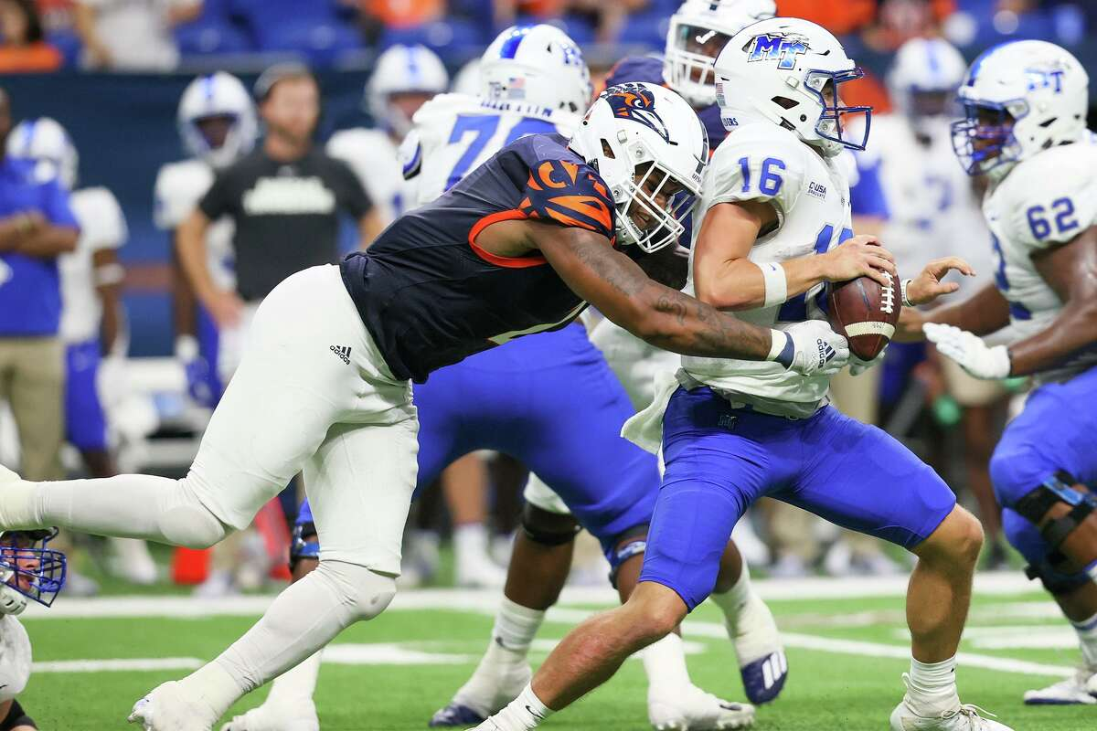 UTSA linebacker Charles Wiley sacks Middle Tennessee quarterback Chase Cunningham from behind during the second half of their opening Conference USA football game at the Alamodome on Saturday, Sept. 18, 2021. UTSA beat Middle Tennessee 27-13.