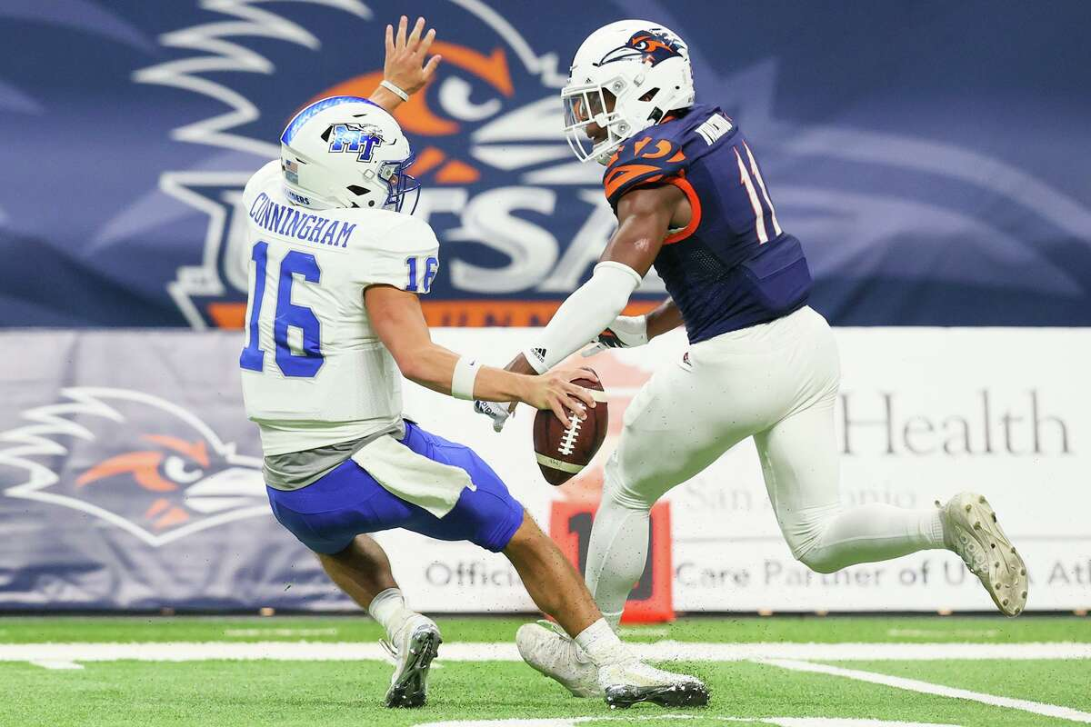 UTSA safety Kelechi Nwachuku pressures Middle Tennessee quarterback Chase Cunningham during the second half of their opening Conference USA football game at the Alamodome on Saturday, Sept. 18, 2021. UTSA beat Middle Tennessee 27-13.