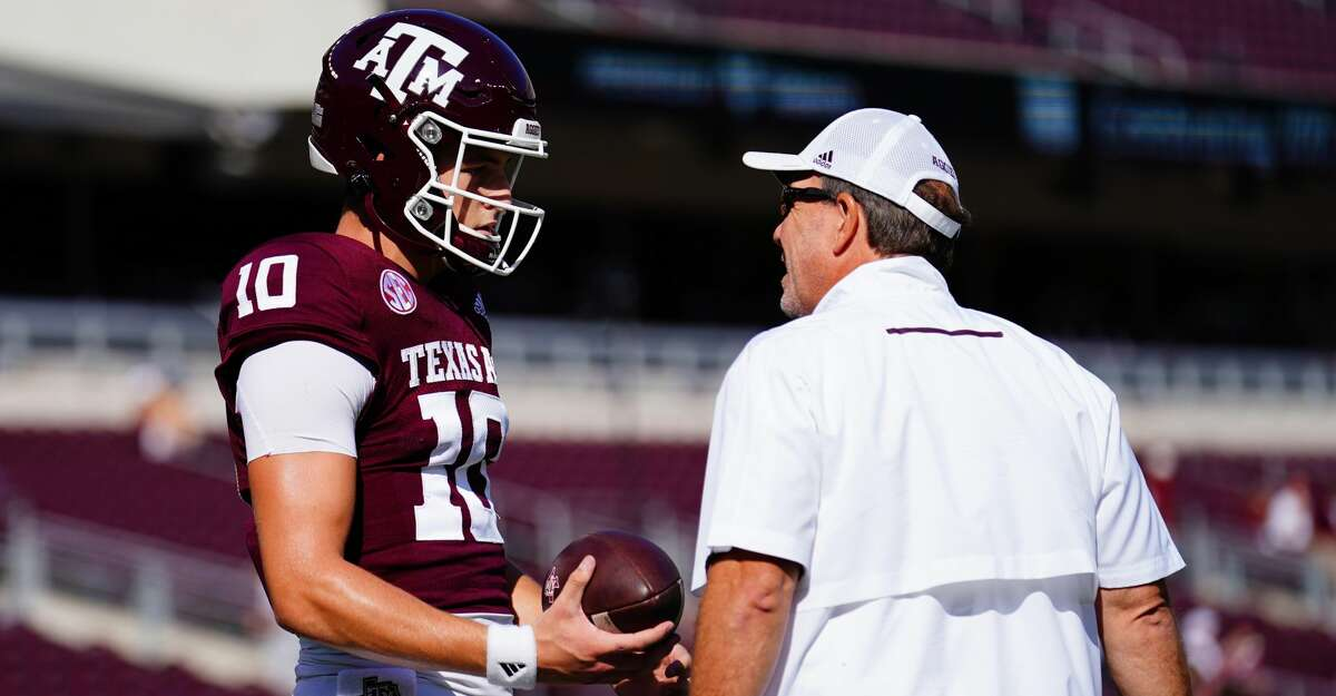 Quarterback Zach Calzada #10 of the Texas A&M Aggies and head coach Jimbo Fisher talk before the game between Texas A&M Aggies and the New Mexico Lobos at Kyle Field on September 18, 2021 in College Station, Texas. (Photo by Alex Bierens de Haan/Getty Images)