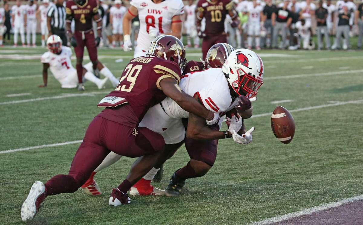 UIW running back Kevin Brown looses the ball on the goal line after being hit by Texas State defenders. FBC Texas St-UIW on Saturday, Sept. 18, 2021.