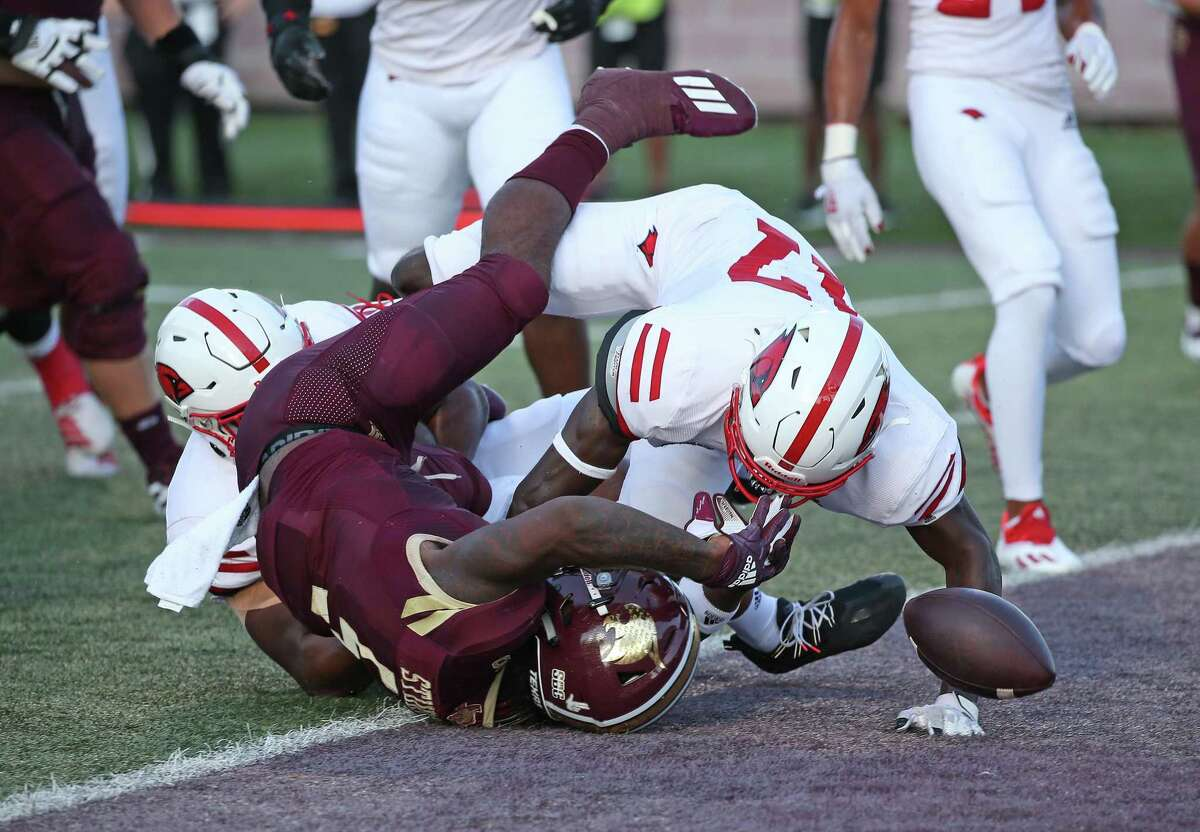 Texas State running back Marcus Brown fumbles the ball on the goal line but a penalty gave them back possession. FBC Texas St-UIW on Saturday, Sept. 18, 2021.