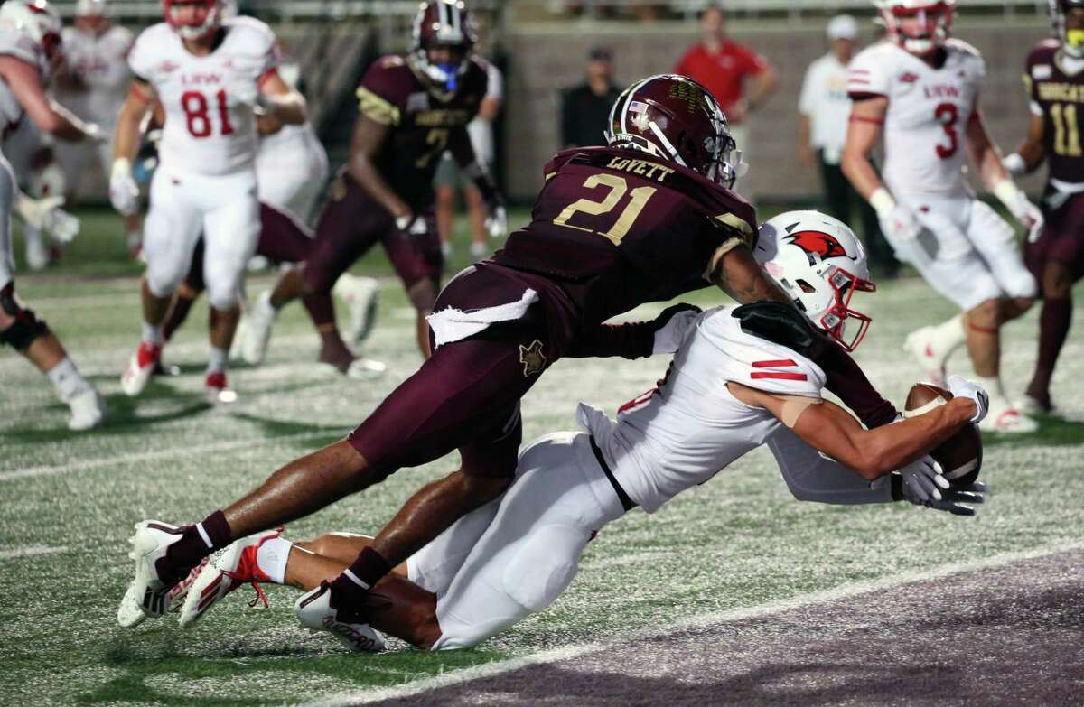 UIW Darion Chafin(0) catches the go ahead touchdown as Texas State Michael LoVett is draped on him. UIW defeated Texas State 42-34.