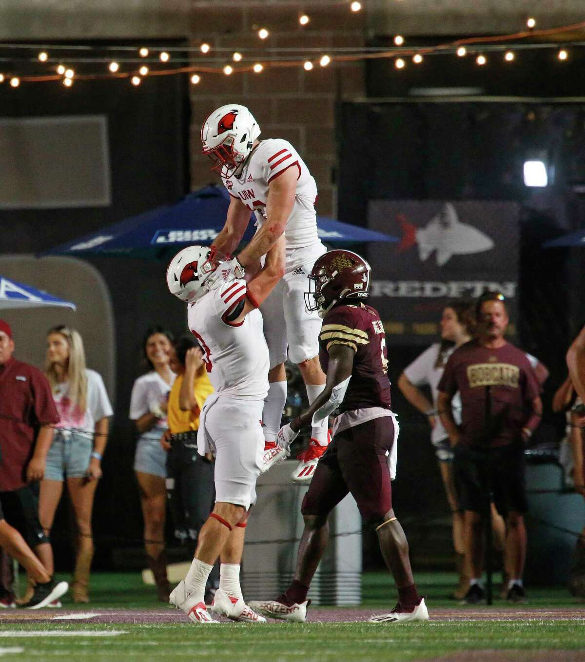 UIW's Taylor Grimes, center, was the Cardinals' second-leading receiver with 11 catches for 113 yards and a touchdown in UIW's win over Texas State, its first win over an FBS team.