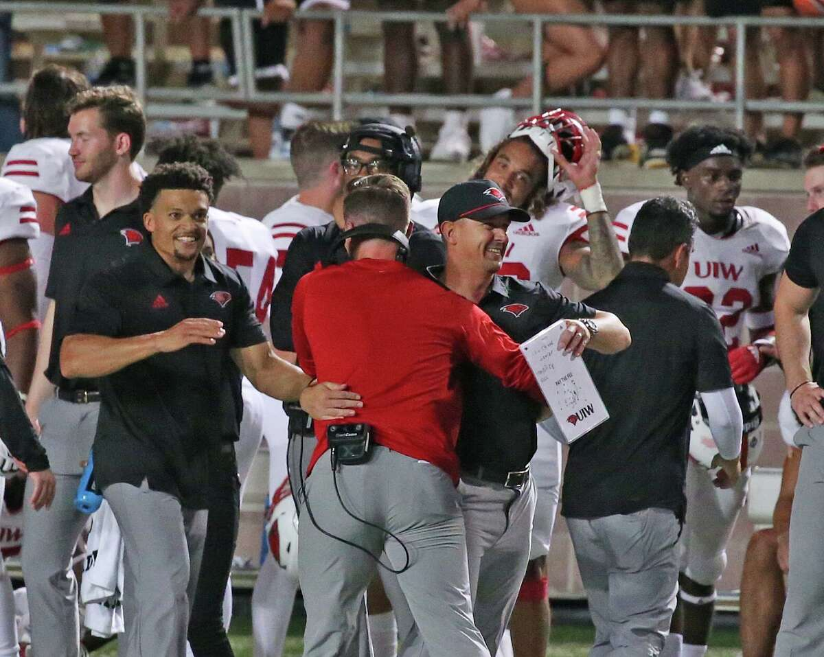 UIW head coach Eric Morris,wearing hat is congratulated after UIW defeated Texas State 42-34 on Saturday, Sept. 18, 2021.