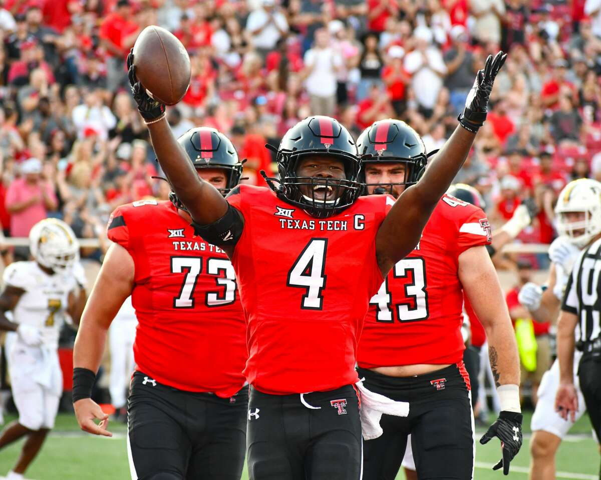 Running back SaRodorick Thompson celebrates his 1-yard touchdown on his first touch of the year.