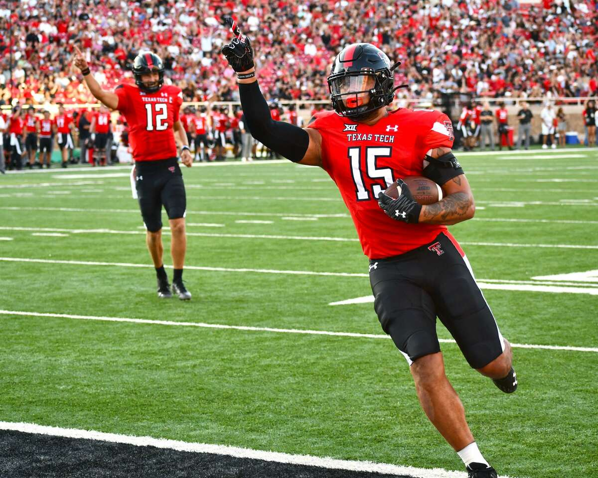 Travis Kootnz (15) and Tyler Shough celebrate their touchdown connection during Texas Tech's non-conference football game against Florida International on Saturday in Jones AT&T at Lubbock.