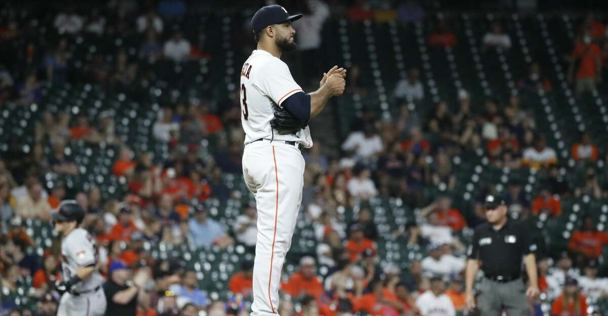 Houston Astros relief pitcher Yimi Garcia (93) reacts as Arizona Diamondbacks Daulton Varsho (12) rounds the bases after his home run during the tenth inning of an MLB baseball game at Minute Maid Park, Saturday, September 18, 2021, in Houston.