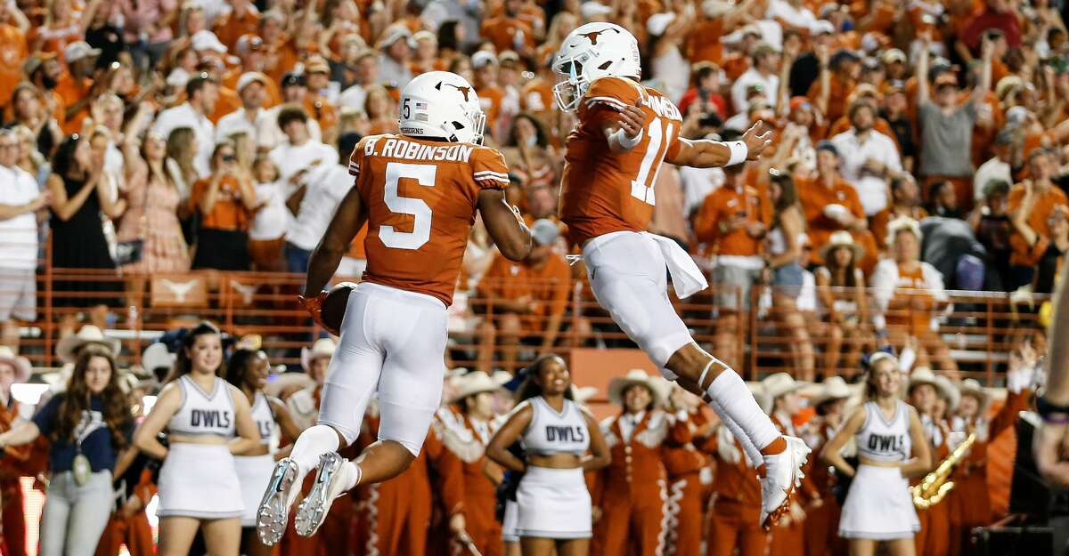Casey Thompson #11 of the Texas Longhorns congratulates Bijan Robinson #5 after a rushing touchdown in the second quarter against the Rice Owls at Darrell K Royal-Texas Memorial Stadium on September 18, 2021 in Austin, Texas. (Photo by Tim Warner/Getty Images)